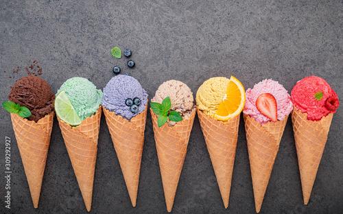 Obraz na plátně  Flat lay ice cream cones collection on dark stone background