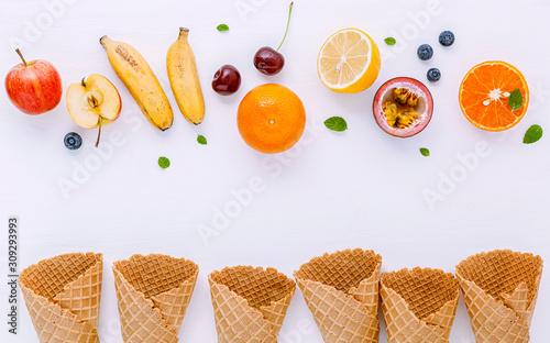 Fotografie, Obraz  Flat lay various fresh fruits blueberry ,strawberry ,orange ,banana ,passion fruit ,apple and cherry setup on white background