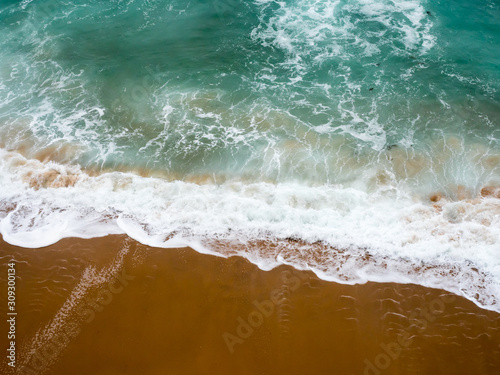 Photo Abstract images of the mighty pacific ocean crashing ashore along the great ocea