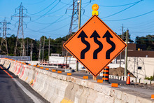 Temporary Detour From Normal Traffic Route, Three Lines Road, Temporary Condition Signs On Road Cement Barriers, Work Zone In The Background