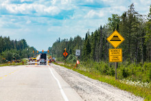 Temporary Condition Road Warning Signs On The Roadside Before Road Work Zone, Rumble Strips On A Bilingual Yellow Sign, Canadian Rural Roads