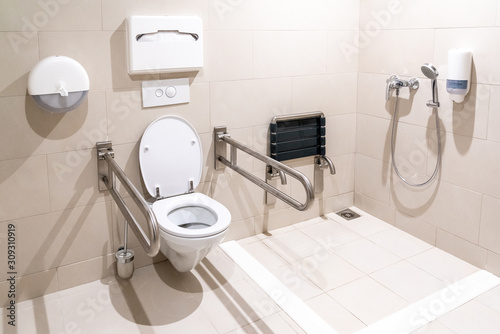 Obraz Public restroom for disabled handicapped people with special equipment - fototapety do salonu
