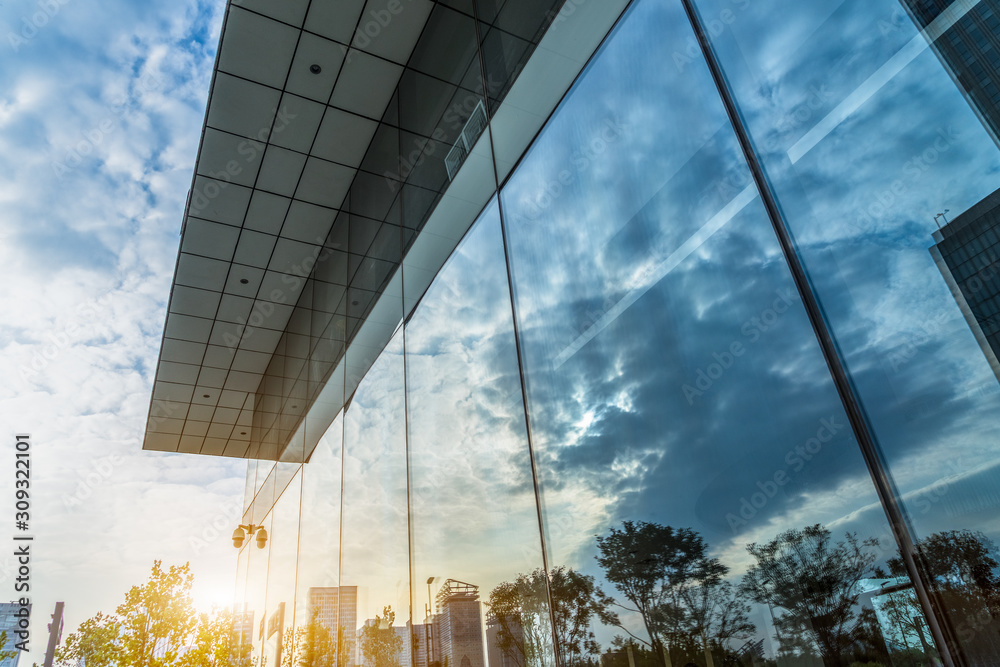 Fototapeta Reflection of architecture on modern office building
