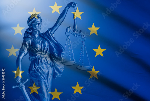Statue of Justice over a European Union Flag