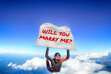 Will You Marry Me. Flag In Skydiving. People In Free Fall.Teampleat Skydiver. Extreme Sport.