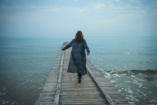 Young Girl Walking On The Pier...