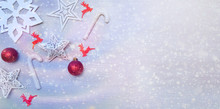 Red-White Christmas Card With Stars, Baubles, Reindeer And Sugar Canes.