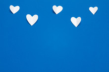 White Paper Hearts At Blue Bac...