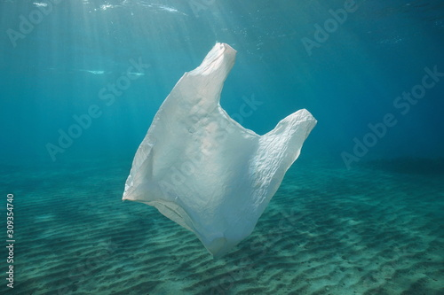 A white plastic bag adrift underwater pollution in the ocean Wallpaper Mural
