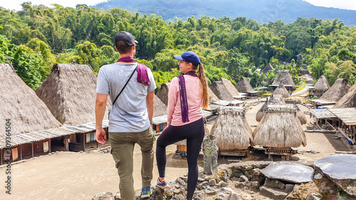 Cuadros en Lienzo  A couple with a purple scarfs admiring the Beno village in Flores, Indonesia