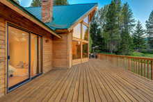 Luxury Summer Mountain Cabin Home With Large Wooden Porch And Bedroom View.