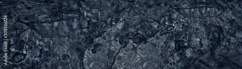 Dark blue weathered broken concrete surface panoramic texture. Old cracked ce...