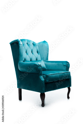elegant velour blue armchair with pillow isolated on white Wallpaper Mural