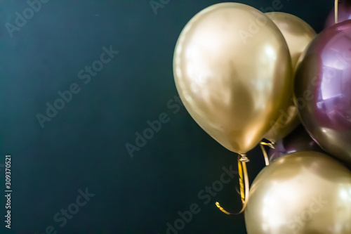 Fototapeta Set of gold and purple balls on a dark background. Holiday concept, postcard obraz