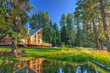 Luxury Cedar cabin home with Large porch, pine trees and pond