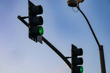 Traffic Street Light Hanging From Support Pole Glowing Red