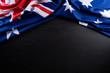 Leinwanddruck Bild - Australia day concept. Australian flag with the text Happy Australia day against a blackboard background. 26 January.