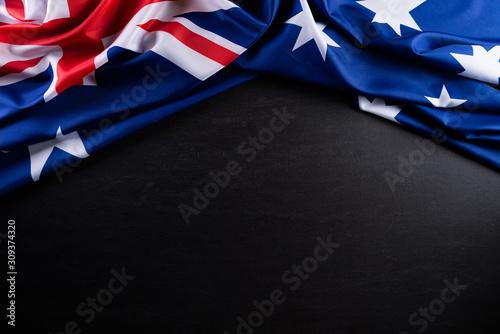 Obraz Australia day concept. Australian flag with the text Happy Australia day against a blackboard background. 26 January. - fototapety do salonu