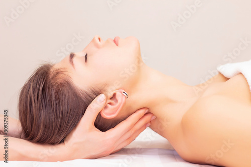 Photo massage and stretching of the cervical muscles