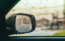 Blurred Rain Drop On The Car G...