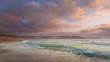 Golden pastel sunset over Fistral beach in Cornwall England