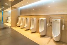 White Urinals In Men Public Re...