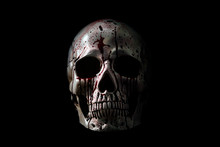 Human Skull In Blood Isolated On Black Background With Clipping Path