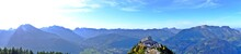 Panorama Of The Gorgeous View Of Gigantic Mountains And The Eagle's Nest (The Kehlsteinhaus) Is A Third Reich-era Building Erected Atop The Summit Of The Kehlstein, Berchtesgaden, Germany.