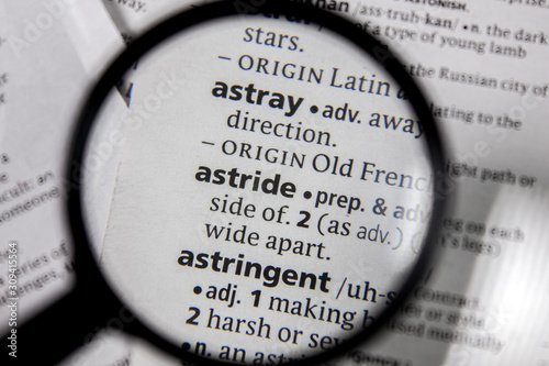 The word or phrase astride in a dictionary. Canvas Print