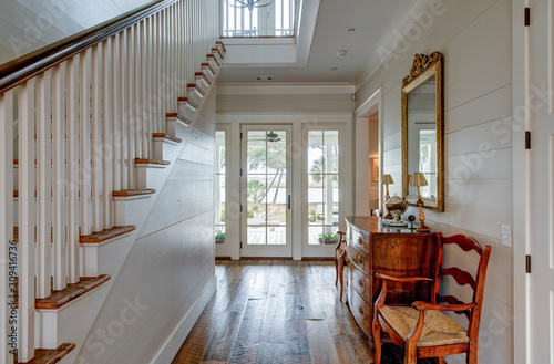 Luxury home entry foyer with view out onto waterfront property. Fototapeta