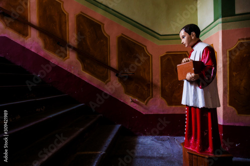 Photo acolyte with collecting box for gifts in church