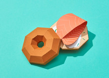 Handmade Origami From Paper - Fish Burger With Peace Of Salmon On A Turquoise Background.