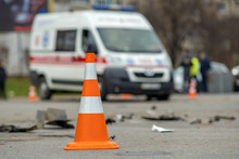 Yellow Plastic Cone Placed On A Street At Car Accident Crash Site.