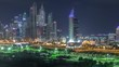 Dubai Marina illuminated skyscrapers and golf course night timelapse, Dubai, United Arab Emirates. Aerial view from Greens district
