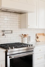 Modern Stovetop In White Kitchen