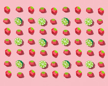 Pattern From Handmade Craft Paper Lime And Ripe Strawberries On A Rose Background. Fruit Layout For Your Ideas. Flat Lay
