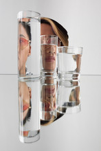Woman Wearing Sunglasses Distorted Through Glasses With Water