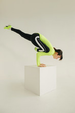Young Athlete Performing Handstand On Cube
