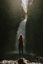 Backside Of Girl Looking At A Waterfall