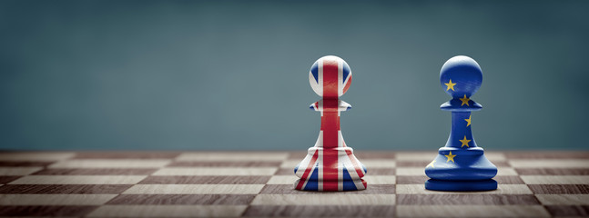Brexit concept. United Kingdom and European Union flags on chess pawns.