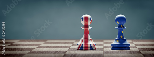 Fototapeta Brexit concept. United Kingdom and European Union flags on chess pawns. obraz