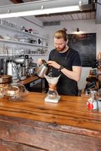 Man Brewing Coffee In Chemex