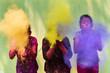 Tree girls blowing coloful gulal and making fun in holi festival