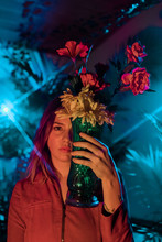 Woman Holds Flower Vase In Front Of Face