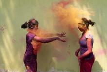 Two Teenage Girls Throwing Gul...
