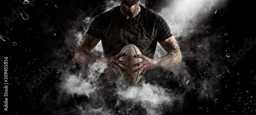 Rugby player in action on dark Fotobehang