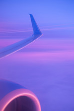 Wing Of Plane Flying In Twilig...