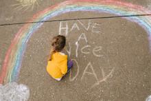Little Girl Writes Chalk Message In Street