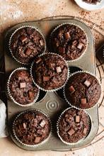 Group Of Chocolate Muffins Into A Muffin Tin