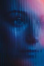 Woman Through Textured Glass In Dark Neon